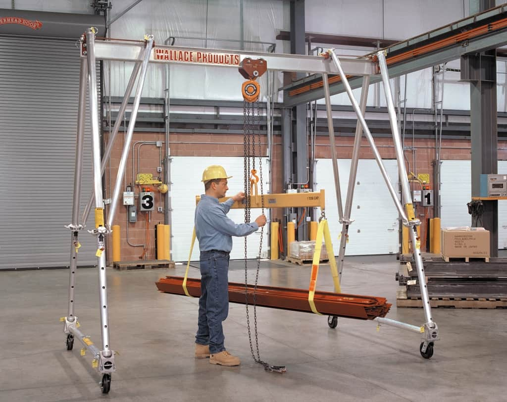 Material handling equipment application using Wallace Model A2T10-A10AC 1 Ton Aluminum Tri-Adjustable Gantry Crane, Wallace Model 70-1610 1 Ton Push Trolley and Model 5-214-10 Harrington Manual Hoist.